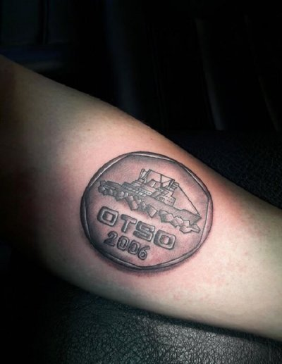 Coin tattoo